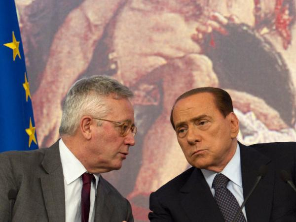 Italian Premier Silvio Berlusconi, right, and Finance minister Giulio Tremonti at a new conference in Rome on Aug. 5. The European Central Bank has agreed to help Italy with its debt crisis, but is demanding tough austerity measures.