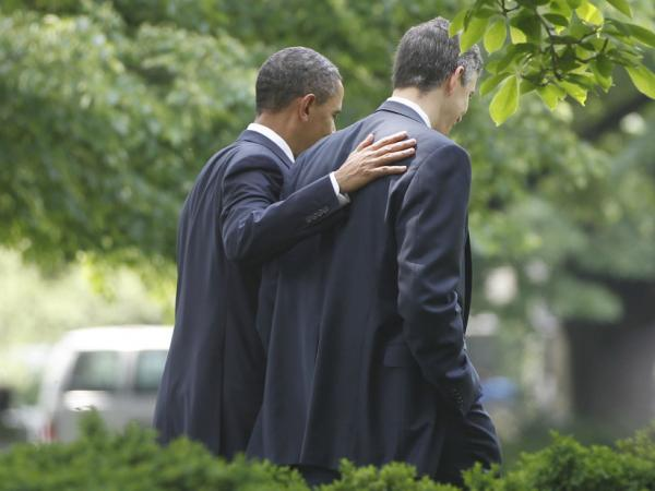 President Barack Obama walks with Education Secretary Arne Duncan at the White House in Washington in May. Duncan wants school to meet a set of condition in order to take advantage of the president's education waivers.