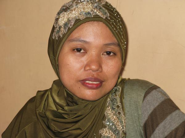 Siami, a curtain-maker who goes by one name, is mother of Alifah Achmad  Maulana. Neighbors hounded the family out of their village outside Surabaya, Indonesia, after she  complained about cheating on the national high school entrance exam at the village public  school.