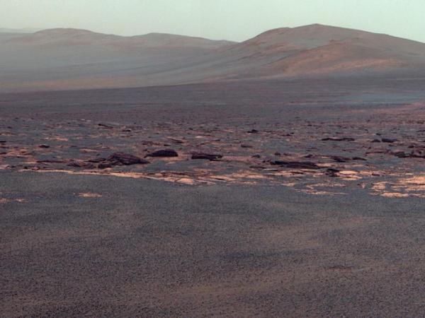 "A portion of the west rim of Endeavour crater sweeps southward in this view from NASA's Mars Exploration Rover Opportunity. NASA adjusted the colors in this image. Fans of the film <em>Capricorn One</em> may want to see the <a href=""http://www.nasa.gov/mission_pages/mer/multimedia/gallery/pia11508.html"">original orange-tinted image</a>."