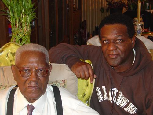 Robinson (right) with his father, Jesse Fulmore. Robinson lives in Minnesota; Fulmore lives in Philadelphia.