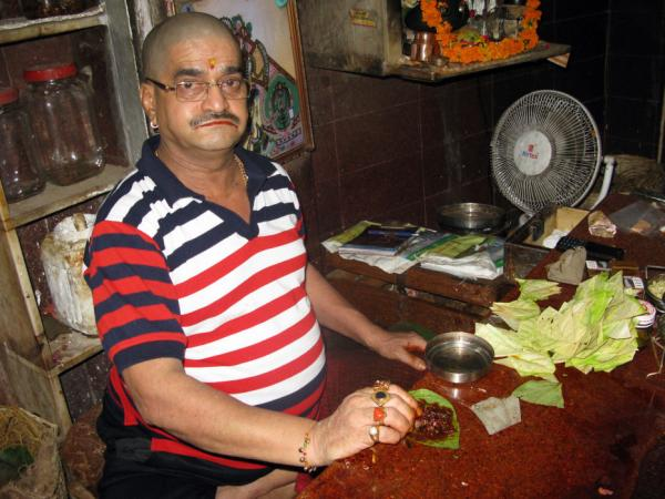 <em>Paan</em> seller Jitender Verma sits in his shop in old Delhi's Chandni Chowk Market. He has been making and selling <em>paan</em> in this family business for 40 years, but now faces competition from a cheap form of chewing tobacco.