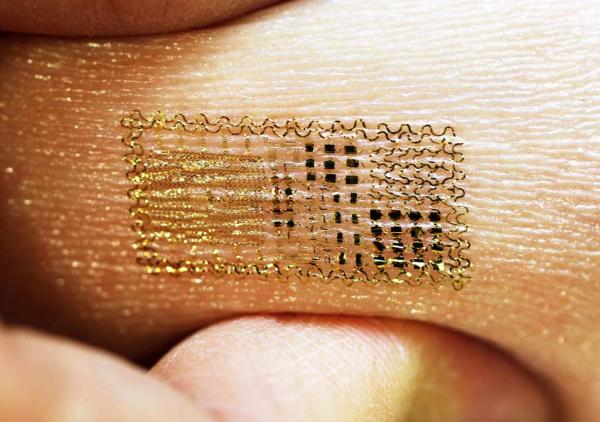 A new type of sensor uses flat, flexible electronics printed on a thin rubbery sheet, which can stick to human skin for at least 24 hours.