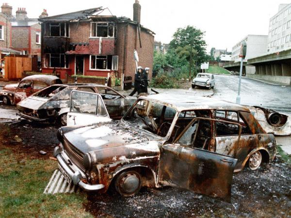 Burnt out cars are seen following attacks on police and firefighters in Tottenham in London, October 1985. Riots in London in August 2011 seem to mirror attacks like this.