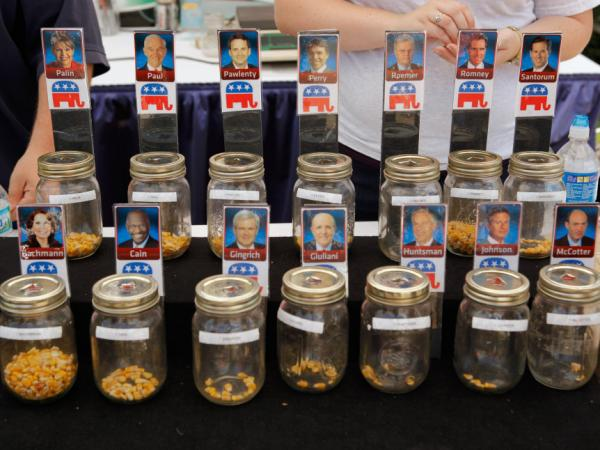Voters put corn kernals into jars with their favorite Republican presidential candidates on the first day of the Iowa State Fair August 11 in Des Moines.