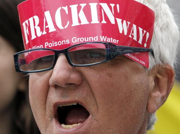 Dave Channon of Shandaken, N.Y., shouts during a rally against hydraulic fracturing for natural gas in the Marcellus Shale region of the state, at the Capitol in Albany, N.Y. in April. Pundits and news organizations have become critical of recent <em>New York Times</em> coverage of the fracking controversy.