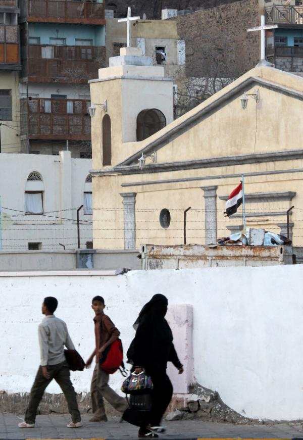 Yemenis walk past Saint Anthony Church in the southern city of Aden in 2010. Two months ago, tens of thousands of residents fled to Aden from their homes in Zinjibar after militants stormed the town. The displaced persons are now camped out in schools in Aden.