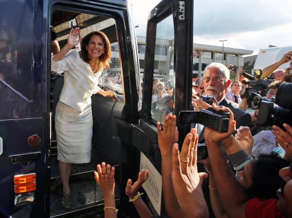 Republican presidential candidate Rep. Michele Bachmann steps from her campaign bus to greet supporters after winning the Iowa Republican Party's Straw Poll in Ames, Iowa, Saturday, Aug. 13, 2011.