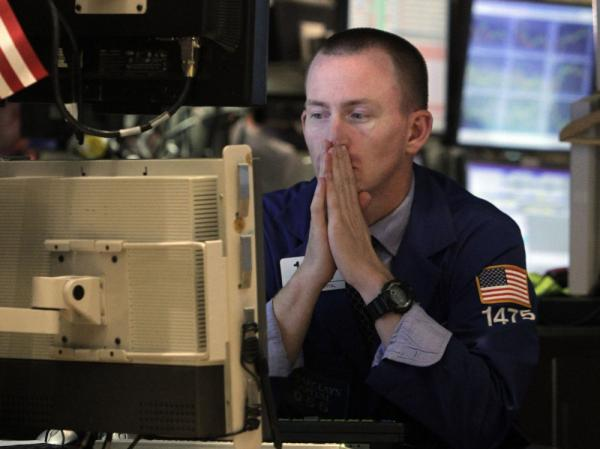 Specialist James Ahrens works at his post on the floor of the New York Stock Exchange Wednesday, Aug. 10, 2011. The stock market has fluctuated greatly since the United States' credit rating was lowered.