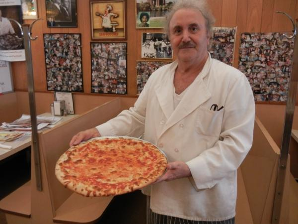 Nick Azzaro, owner of Papa's Tomato Pies, poses with one of his creations. Azzaro, who is now 64, says he's been making pizzas since he was 14 years old.