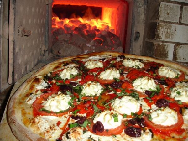 Pizza before it is put in a coal-burning oven at Lombardi's. Lombardi's opened its doors in 1905 in Manhattan's Little Italy neighborhood.