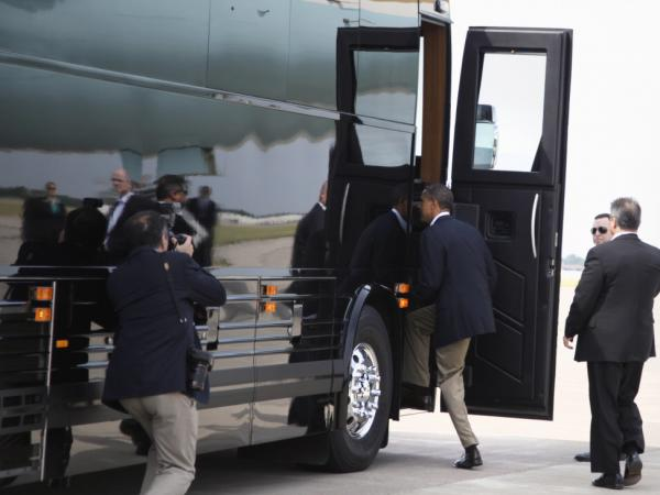 President Obama boards his bus after arriving at Minneapolis-St. Paul International Airport on  Monday, to start his three-day economic tour.