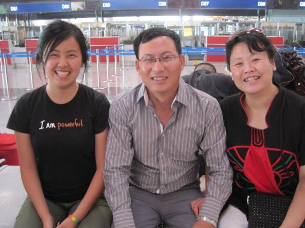Mandy with her parents at the Beijing airport.