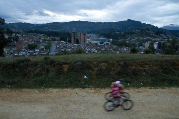 Two riders from a cycling academy ride during an early morning hill training session in Duitama.