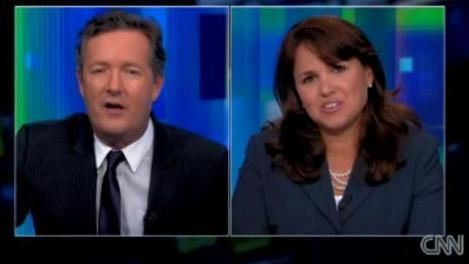 Piers Morgan, left, and Christine O'Donnell before she left the set last night.