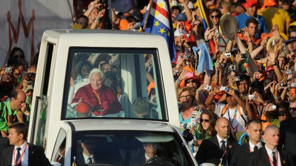 Young Catholics welcome Pope Benedict XVI as he arrives at Cibeles Square during World Youth Day celebrations on Aug. 18, in Madrid, Spain.