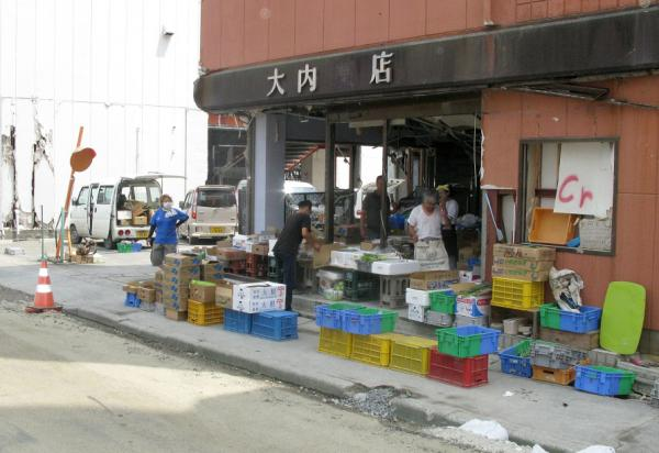 Hiromitsu Miyagawa has set up a fruit and vegetable stand in this abandoned pharmacy. Miyagawa's business is one of the few to open in the tsunami zone.