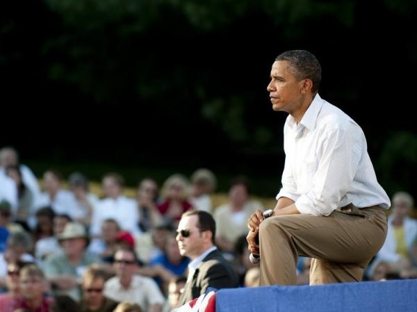 US President Barack Obama listens to questions as he speaks at a town hall style meeting in Decorah, Iowa, August 15, 2011, during his three-day bus tour in the Midwest centering on ways to grow the economy.