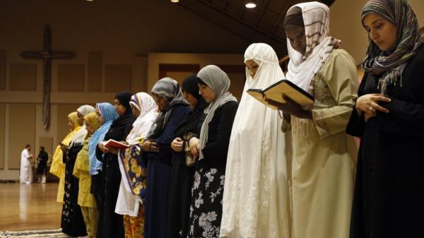 Members of the Memphis Islamic Center pray at Heartsong Church in Cordova, Tenn., last year.