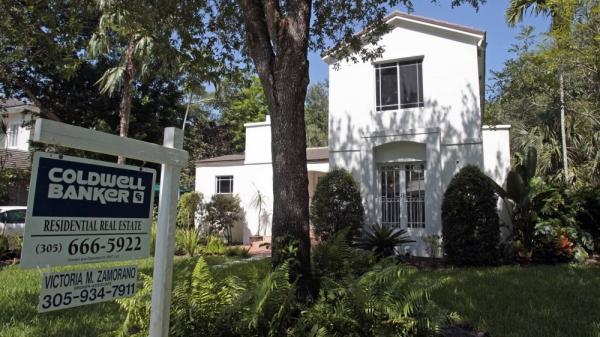 A house, like this one in Miami, represents a part of the American dream. But should the government help people attain it?