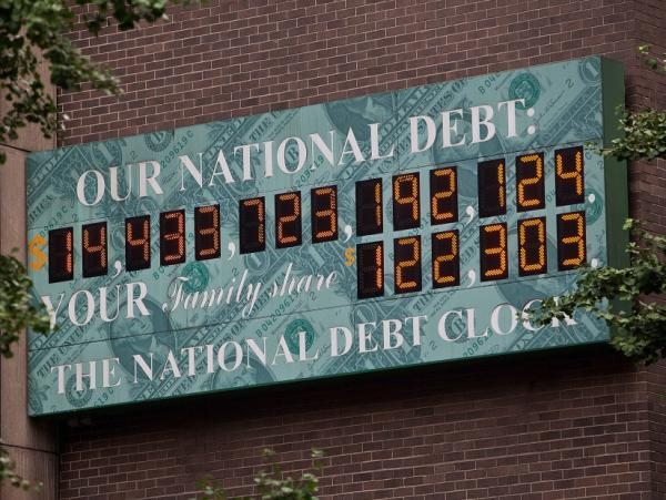 <strong>$14.4 trillion and counting: </strong>The National Debt Clock, a billboard-size digital display showing the increasing U.S. debt, is seen in New York City on Aug. 1.