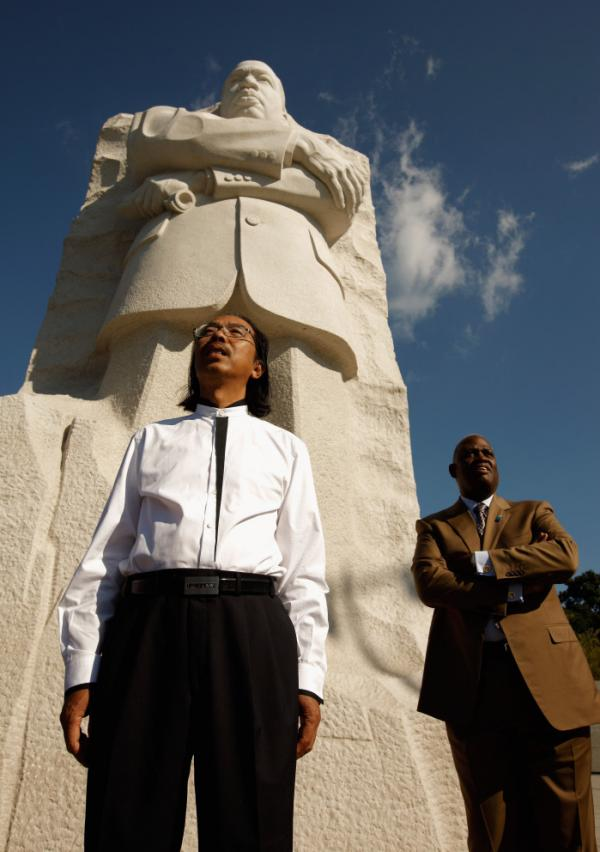 Master Sculptor Lei Yixin and Harry Johnson, president and CEO of the Martin Luther King Jr. National Memorial Project Foundation, stand at the base of the 30-feet-tall sculpture at the new King memorial.