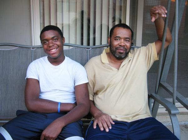 Clyde Jackson (right) poses for a photo with his son, Clyde Jr., outside their new two-bedroom apartment in Greenbelt, Md. Jackson lost his three-bedroom home to foreclosure in December.
