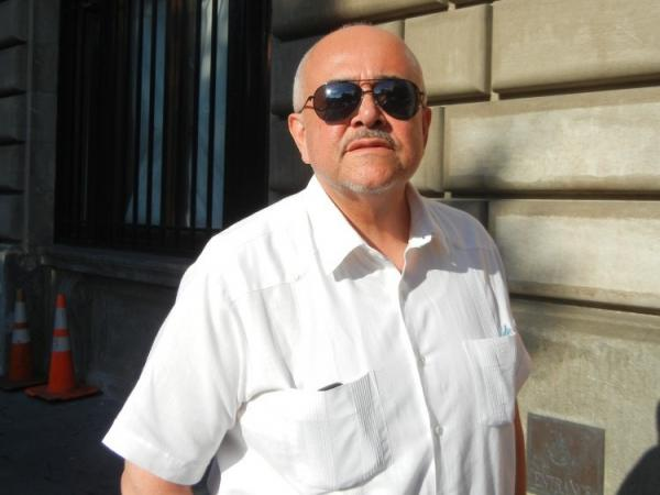 Gerson Borrero, who was an activist with the Committee Against Fort Apache, stands in front of the building in August 2011.