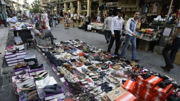 Syrian street vendors display their goods in downtown Damascus on Tuesday, Aug. 23. Syria's economy was hit hard initially by the anti-government uprising. It has bounced back, but now the U.S. is urging the E.U. to join in banning import of crude oil from Syria.