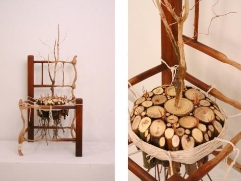 A child's wooden chair was recovered in the wreckage and entwined with a tree-shaped  limb and copper to show a rebirth, by artist Matthew Dehaemers.