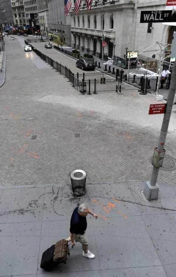 Earlier today, a man pulled his luggage up Wall Street — one of the low-lying areas — in Manhattan.