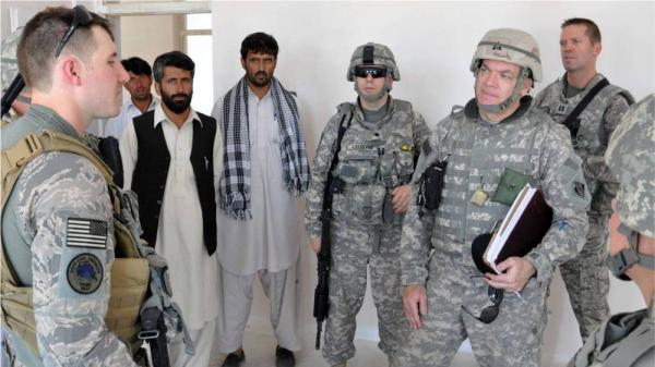 Rex Goodnight (right) works with contractors in Afghanistan. His program, Afghanistan Reachback, works to create buildings using the resources Afghans actually have.