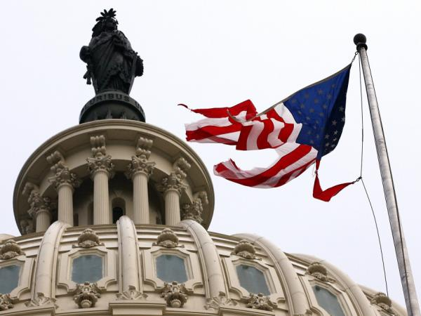 Irene's winds tore the flag that was flying in front of the U.S. Capitol on Sunday.