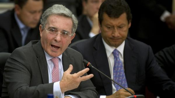 Former Colombian President Alvaro Uribe (left) speaks during a public congressional hearing in Bogota Aug. 8 about allegations that the country's intelligence service spied on high court judges during his government.