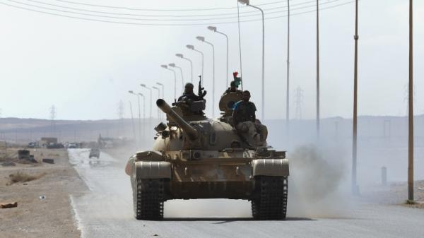 Libyan rebel fighters advance in their tank about 60 miles east of the town of Sirte on Tuesday, Aug. 30. Sirte is Moammar Gadhafi's hometown and the last bastion of his loyalist forces.