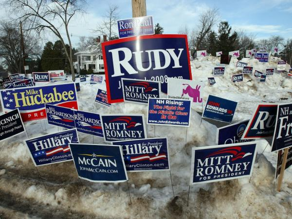 Campaign posters are seen in a snowbank outside a polling place in Jan. 2008 in Manchester, N.H.