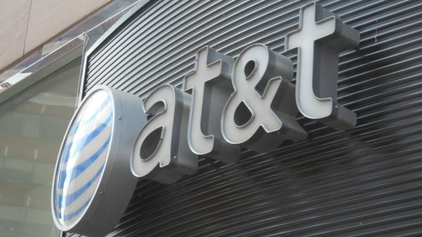 This June 2, 2010 file photo shows the AT&T logo in Washington DC. The US Justice Deparment will seek to block AT&T's proposed $39 billion acquisition of T-Mobile.