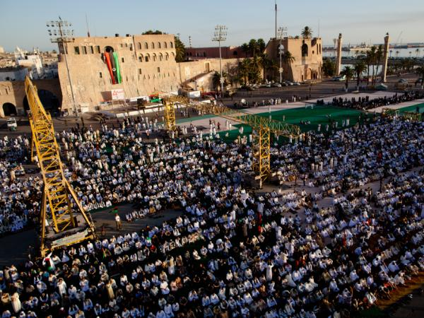 Muslims gather at Martyr's Square in Tripoli for Eid prayers Wednesday. Despite joy over the rebel takeover of the city, residents still face water and electricity shortages and high food prices.