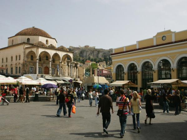 Athens' Monastiraki neighborhood is a meeting place for Greek and Ottoman culture. Case in point: the 18-century Tzistarakis Mosque (left) sits below the Acropolis (center) and serves as a focal point for Monastiraki Square.