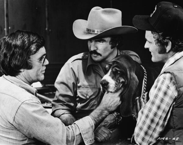Veteran Hollywood stuntman Hal Needham — who turned director for the 1977 hit <em>Smokey and the Bandit</em> — lines up a shot with Burt Reynolds, Jerry Reed and Happy the dog.