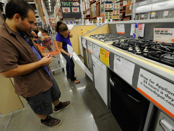 Customers shop for kitchen appliances at a Home Depot store in the Hollywood section of Los Angeles.