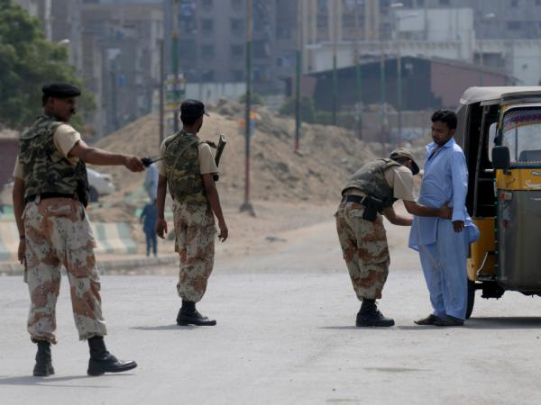 A Pakistani paramilitary soldier frisks a man on a cordoned-off street during house-to-house search operations against criminals gangs and extortion mafias in a troubled area of Karachi on Aug. 28.