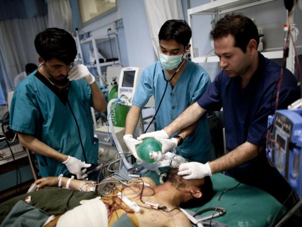 Afghan doctors assist an injured Afghan soldiers at the Davoud Khan military hospital in Kabul, Afghanistan, on April 23, 2011. U.S. medics have traveled to Afghanistan to help train 600 nursing students over a period of two years at a medical training center at the hospital.