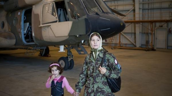 Col. Latifa Nabizada, the only female pilot in Afghanistan, flies her helicopter to some of the most dangerous parts of the country. Her 5-year-old daughter Malalai is often with her in the cockpit.