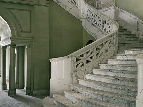 """Photo of the Mead building lobby, Yankton State Hospital, S.D. Photographer Christopher Payne visited state mental institutions across the country, many of which were abandoned. His book, <em>Asylum: Inside The Closed World of State Mental Hospitals</em>, <a href=""""http://www.npr.org/templates/story/story.php?storyId=140146150"""">captures what he found</a>."""