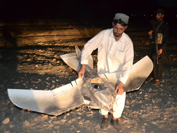 A Pakistani villager holds the wreckage of  a suspected surveillance drone that crashed in the Pakistani town of Chaman along the Afghanistan border, Aug. 25, 2011. The number of drone strikes has increased fivefold during the Obama administration.