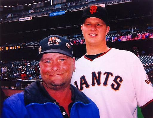 Billy poses for a photo with San Francisco Giants' Pitcher Matt Cain.