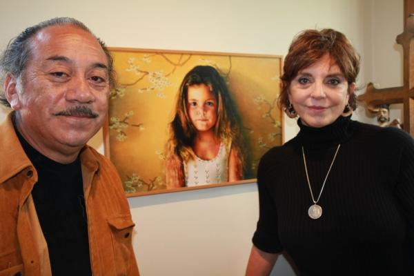 Jody and  Reynaldo Terrazas stand in front of a painting of their oldest daughter. The  Terrazas have lived in Oakland's San Antonio neighborhood for more than 40 years and  raised two girls there.