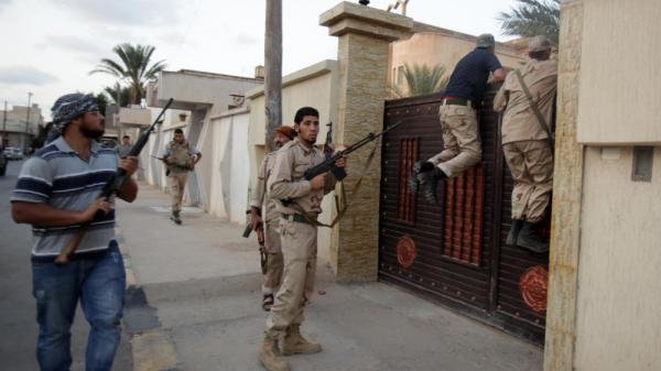 Libyan rebel fighters raid a house in the capital Tripoli on Tuesday as they search for supporters of ousted leader Moammar Gadhafi. The rebel leadership is trying to get various rebel factions to work together to create a new government and security force.