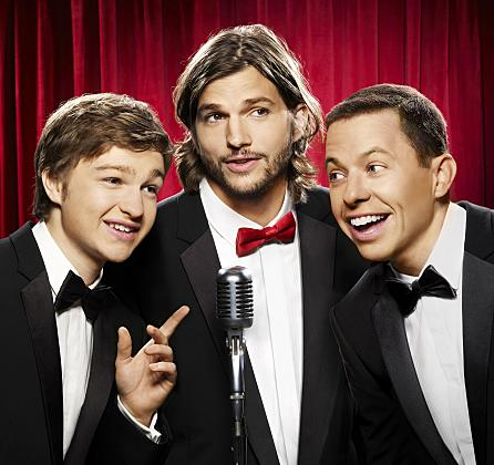 Ashton Kutcher (center) replaces Charlie Sheen on the CBS sitcom <em>Two and a Half Men</em>, which also stars Angus T. Jones (left), and Jon Cryer.